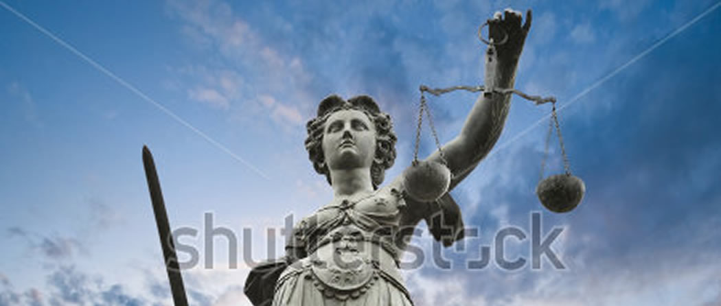 stock-photo-justice-statue-with-sword-and-scale-cloudy-sky-in-the-background-50000521-1050